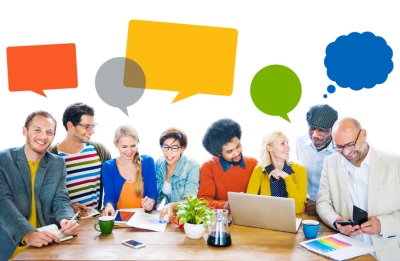 Group of Multiethnic Cheerful Designers with Speech Bubbles